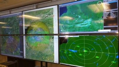 TV screens showing radar