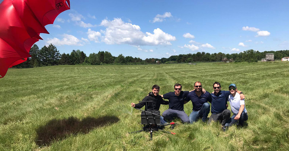 Flytrex with drone and parachute in field
