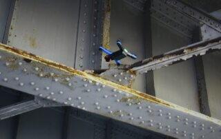 Drone Inspecting Underside of Bridge
